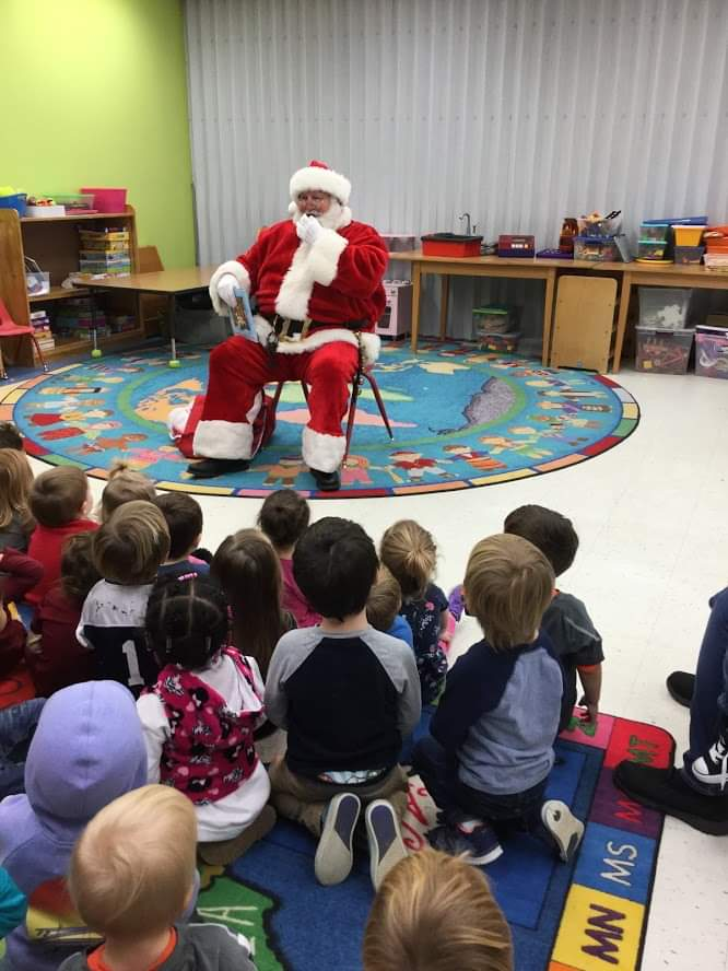Santa Earl reading to preschool